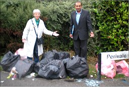 Vanessa McPake and Subhan Shafiq with 8 bags of rubbish put out too late in Perivale, Monkston Park