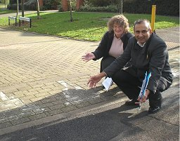 Jenni Ferrans and Subhan Shafiq inspect the repaired road at Sweetlands Corner, Kents Hill