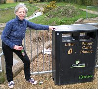 Vanessa McPake at the bin near the brook.