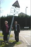 Cllrs Subhan Shafiq and Jenni Ferrans at the leaning sign in Crowborough Lane.