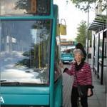 Cllr Vanessa McPake checks the new bus timetables.