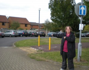 Cllr Jenni Ferrans directs traffic at the new one-way signs at Monkston School