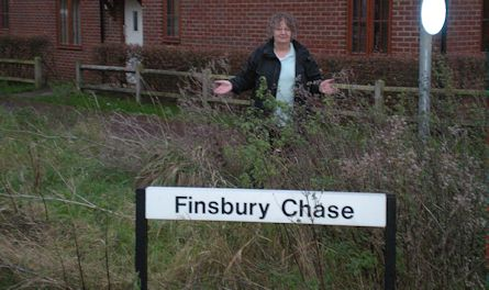 Jenni Ferrans with the land in Finsbury Chase, Monkston Park that no-one wants to own.