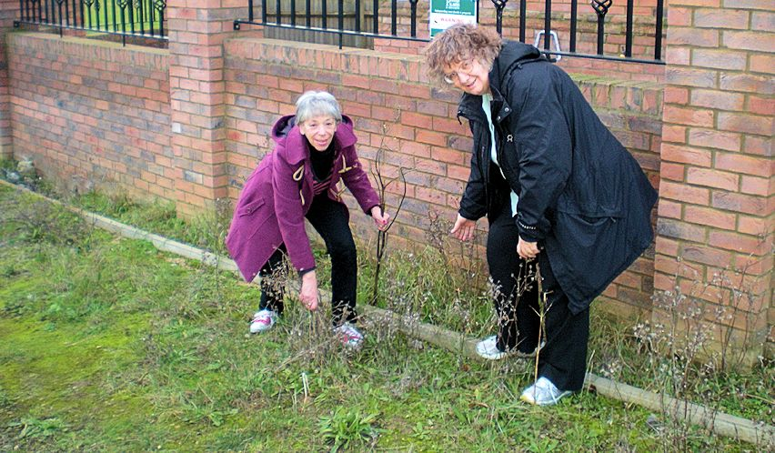 Jenni Ferrans and Vanessa McPake are trying to get Queensbury Lane completed and the weeds cut!