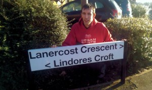 Matt Drewett with the new nameplate for Lindores Croft, Monkston