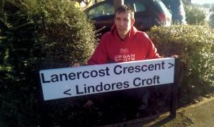 Matt Drewett with the new nameplate for Lindores Croft, Monkston