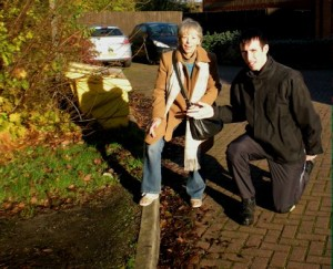 Matt Drewett and Vanessa McPake at the high kerb leading to the redway in Parsley Close, Walnut Tree