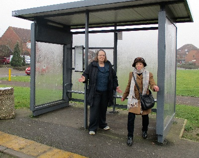 Jenni and Vanessa shivering at the bus shelter in Dunchurch Dale.